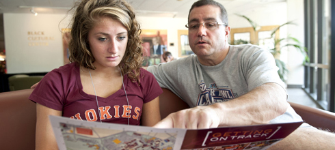 A student looks at a map during orientation.